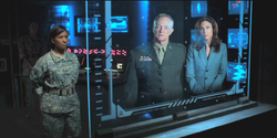 General Riggs (center) with Col. Louise James (left) and Secretary Evelyn Rios (right)