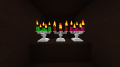 Reliquia Iron Candle Holders.png
