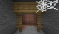 Abandoned mineshaft with fences.png