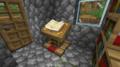 책과 깃펜이 올려진 독서대