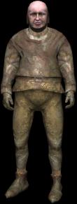 un briquetier couvert de boue