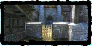 Porte du cimetière, vue du Quartier des marchands