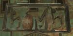 TP Barnes Bomb Shop Metal Sign.png